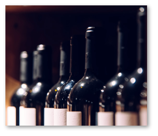 close up of a row of wine bottle