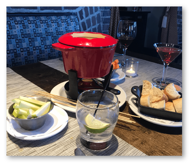 sweet & savory fondue with apples and bread with cocktail and a glass of wine