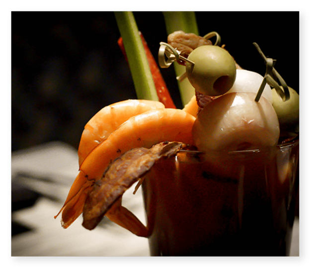 bloody mary with shrimp cocktail onions celery and olives at vin de set
